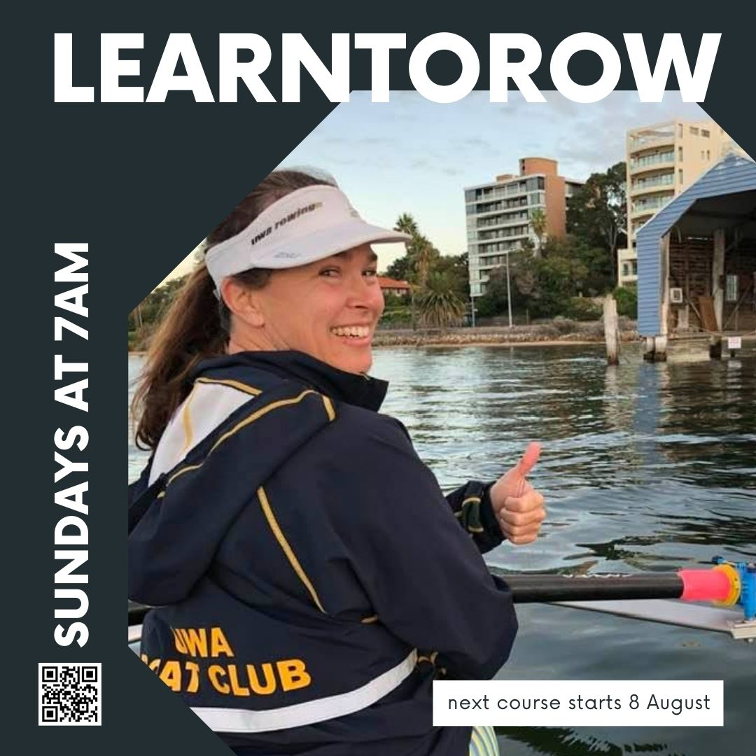 A woman wearing a UWA Boatclub jacket and sitting in a rowing scull gives a thumbs up outside the blue boatshed.